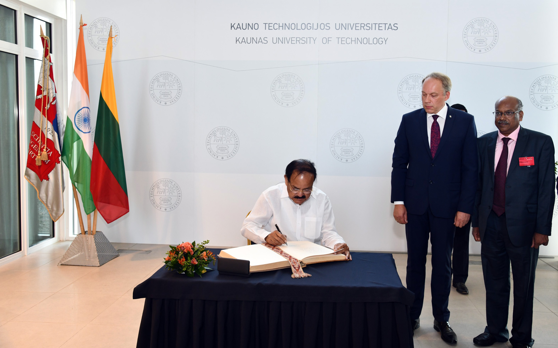 The Vice President, Shri. M. Venkaiah Naidu signing the guest book at the Santaka Valley of the Kaunas University of Technology in Kaunas, Lithuania on August 18, 2019.