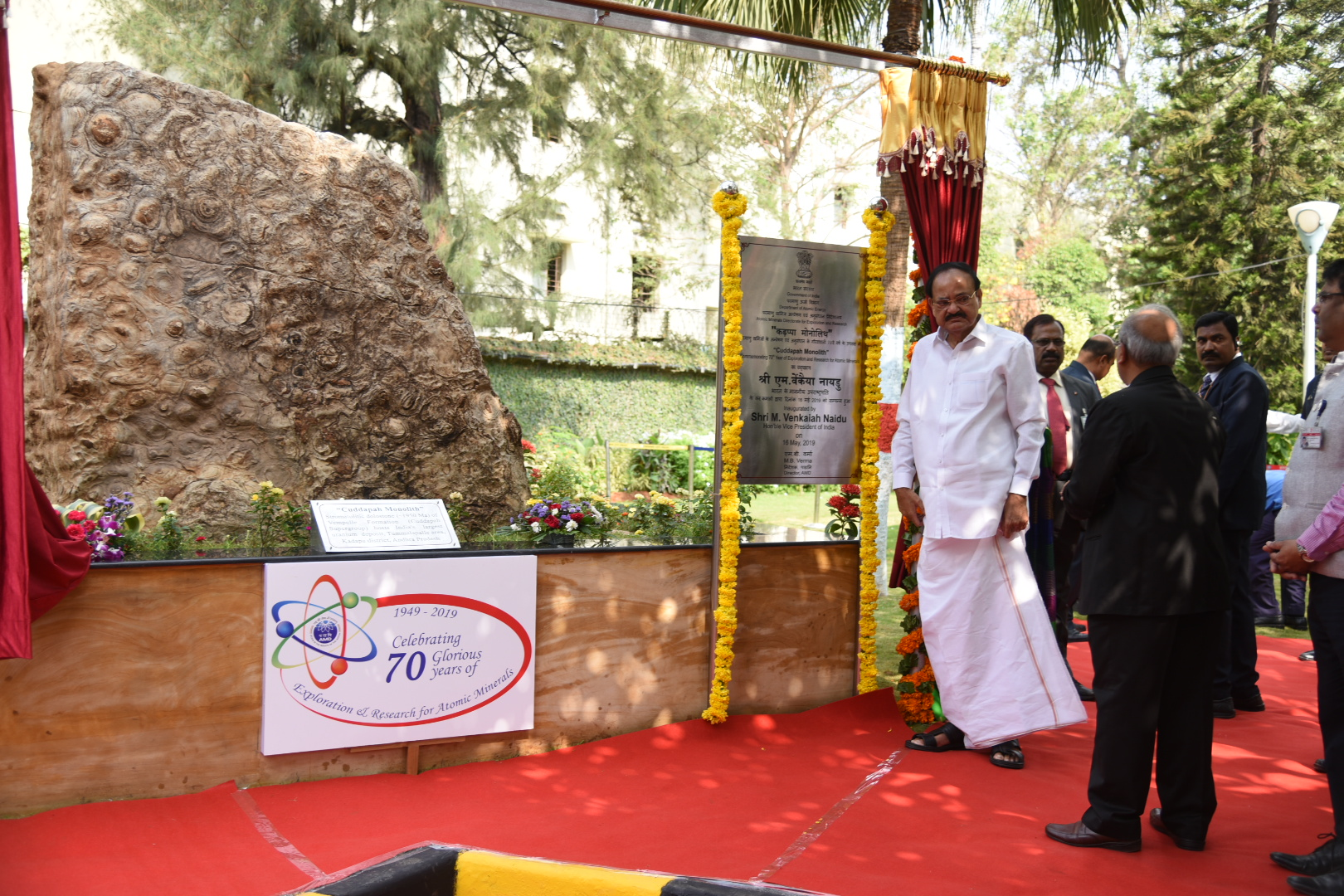 The Vice President, Shri M. Venkaiah Naidu unveiling the plaque of 'Cuddapah Monolith', commemorating 70th Year of Exploration and Research of Atomic Minerals, at the Atomic Minerals Directorate for Exploration and Research, in Hyderabad on May 16, 2019.