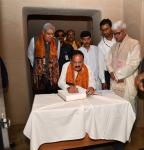 The Vice President of India, Shri M. Venkaiah Naidu signing the visitor's book at 'Shyamoli', the ancestral house of Gurudeb Rabindranath Tagore renovated by the Archaeological Survey of India, in Kolkata on August 16, 2019. The Governor of West Bengal, Shri Jagdeep Dhankar, the Minister for Fisheries Department, West Bengal, Shri Bratya Basu and others are also seen.