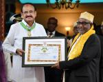 The Vice President, Shri M. Venkaiah Naidu, being conferred  'the order of the Green Crescent', the highest civilian honour of Comoros by the President of the Union of Comoros, Mr. Azali Assoumani, at the Presidential Palace in Moroni, Comoros on October 11, 2019.