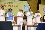 The Vice President, Shri M. Venkaiah Naidu releasing the book 'Utkalamani Gopabandhu' authored by Dr. Subhash Chandra Mishra, at the centennial celebrations of the Odia daily 'the Samaja', in Cuttack, Odisha on October 06, 2019. The Governor of Odisha, Prof. Ganeshi Lal, the Union Minister for Petroleum & Natural Gas and Steel, Shri Dharmendra Pradhan and the Chief Minister of Odisha, Shri Naveen Patnaik are also seen.