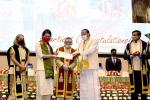 The Vice President, Shri M. Venkaiah Naidu awarding medals to students at the 1st Graduation Day Ceremony of ESIC College & Hospital, Faridabad, in New Delhi on March 07, 2021. The Minister of State for Labour and Employment (Independent Charge), Shri Santosh Kumar Gangwar is also seen.
