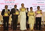 The Vice President, Shri M. Venkaiah Naidu releasing the souvenir at an event to present President's Certificate of Honour and Maharshi Badarayan Vyas Samman Awards, in New Delhi on April 04, 2019.