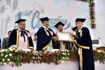 The Vice President, Shri M. Venkaiah Naidu giving away life time achievement award to the Chairperson, Homeopathy University, Dr. Girendra Pal, at the 1st Convocation of Homeopathy University, in Jaipur, Rajasthan on September 26, 2018. The Minister for Health, Rajasthan, Shri Kali Charan Saraf, the Member of Parliament from Rajasthan and President of Sponsoring Society of Homeopathy University, Dr. Manoj Rajoria and other dignitaries are also seen.