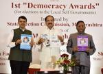 The Vice President, Shri M. Venkaiah Naidu releasing books at an event to present the 1st Democracy Awards instituted by the State Election Commission, Maharashtra, in Mumbai on July 27, 2019. The Chief Minister of Maharashtra, Shri Devendra Fadnavis, the State Election Commissioner, Maharashtra, Shri J.S. Saharia and others are also seen.
