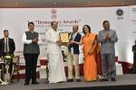 The Vice President, Shri M. Venkaiah Naidu presenting the 1st Democracy Awards instituted by the State Election Commission, Maharashtra, in Mumbai on July 27, 2019. The Chief Minister of Maharashtra, Shri Devendra Fadnavis, the State Election Commissioner, Maharashtra, Shri J.S. Saharia and others are also seen.