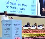 The Vice President, Shri M. Venkaiah Naidu addressing the gathering after inaugurating the 12th Civil Services Day, in New Delhi on April 20, 2018. The Minister of State for Development of North Eastern Region (I/C), Prime Minister's Office, Personnel, Public Grievances & Pensions, Atomic Energy and Space, Dr. Jitendra Singh and other dignitaries are also seen.