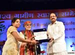 """The Vice President, Shri M. Venkaiah Naidu presenting the awards to Asha Worker / Community Nurse at the 15th World Rural Health Conference with the theme """"Healing the Heart of Healthcare - Leaving no one behind"""", in New Delhi on April 26, 2018. The Minister of State for Health & Family Welfare, Shri Ashwini Kumar Choubey and other dignitaries are also seen."""