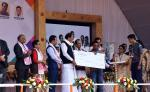 The Vice President, Shri M. Venkaiah Naidu giving away Certificates and Grants to Students after launching Deen Dayal Divyanjan Sahajya Achoni on the occasion of International Day of Persons with Disabilities, in Guwahati, Assam on December 03, 2017. The Governor of Assam, Shri Jagdish Mukhi, the Chief Minister of Assam, Shri Sarbananda Sonowal, the Minister for Social Welfare, Assam, Shri Naba Kumar Doley and other dignitaries are also seen.