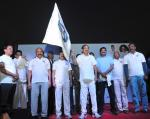 The Vice President, Shri M. Venkaiah Naidu flagging off the 'Walk-A-Thon' organised by the Andhra University Alumni Association, on the occasion of 3rd Annual Meet, in Visakhapatnam, Andhra Pradesh on December 09, 2017. The Minister for Education, Andhra Pradesh, Shri Ganta Srinivasa Rao and other dignitaries are also seen.
