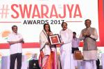 The Vice President, Shri M. Venkaiah Naidu presenting Sree Narayana Guru Award for Social Work to Smt. Laxmi Narayan Tripathi, at an event to present Swarajya Awards 2017, in Panaji, Goa on December 16, 2017. The Chief Minister of Goa, Shri Manohar Parrikar and the Minister of State for Civil Aviation, Shri Jayant Sinha are also seen.