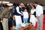 The Vice President, Shri M. Venkaiah Naidu interacting with a boy, Master Ravikar Reddy who spent 4 days in BSF Camp at Indo-Pak boarder, at the 52nd Raising Day Ceremony, in New Delhi on December 01, 2017. The Director General, BSF, Shri K.K. Sharma is also seen.
