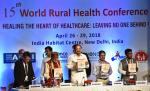 """The Vice President, Shri M. Venkaiah Naidu releasing the souvenir on the 15th World Rural Health Conference with the theme """"Healing the Heart of Healthcare - Leaving no one behind"""", in New Delhi on April 26, 2018. The Minister of State for Health & Family Welfare, Shri Ashwini Kumar Choubey and other dignitaries are also seen."""